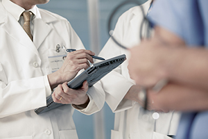 Healthcare professionals using an electronic health record device